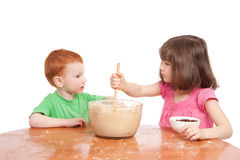 Kids talking while baking Stock Image