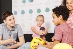 Kids talking in international school. Kids talking during lesson in international school stock photo