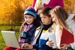 Kids talking with laptop outside Royalty Free Stock Images