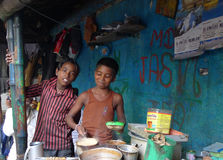 Kids' tea bar - Kolkata (Calcutta - India, Asia). Kolkata tea bar run by kids on the street, Chawringhee - Kolkata (Calcutta - India, Asia stock image