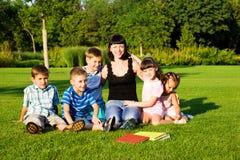 Kids and teacher stock image