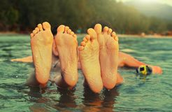 Kids teenager feet close up photo in the sea on the tropical. Beach background Royalty Free Stock Photos