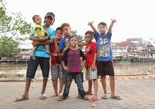 Kids and teens posing on bank of river in Manado Royalty Free Stock Image