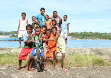 Kids and teens posing on bank of sea in Manokwari Stock Images