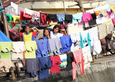 Kids and teens posing among laundry in Manado Royalty Free Stock Photo