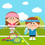 Kids tennis players at tennis court taking a break Royalty Free Stock Photography