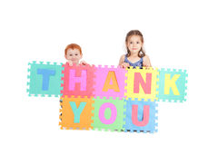 Kids thank you sign. Two kids holding up sign saying thank you. Isolated on white Stock Photo