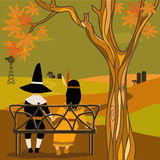 Kids in Thanksgiving costumes sitting under a tree Royalty Free Stock Image