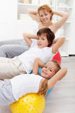 Kids with their mother doing gymnastic exercises Royalty Free Stock Image