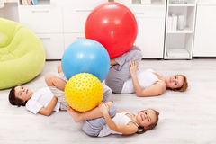 Kids and their mother exercising at home Royalty Free Stock Image