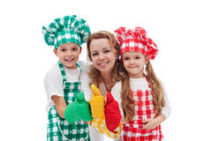 Kids and their mother preparing food together Royalty Free Stock Photo