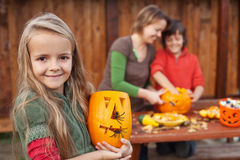 Kids and their mother preparing for Halloween Royalty Free Stock Photography