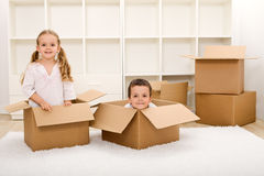 Kids in their new home with boxes Royalty Free Stock Photography