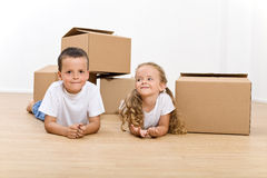 Kids in their new home still unpacking Stock Images