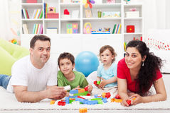 Kids with their parents playing Stock Photo