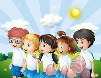 Kids in their school uniform walking at the hill Stock Images