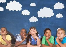 Kids thinking and blue wall with clouds. Digital composite of Kids thinking and blue wall with clouds Royalty Free Stock Photography