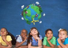 Kids thinking together and blue wall with planet earth world Royalty Free Stock Photo