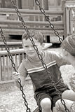 Kids on tire swing Royalty Free Stock Images