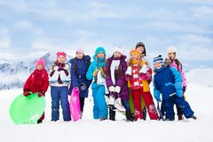 Kids together outside on cold winter day Royalty Free Stock Photo