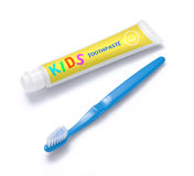 Kids Toothpaste and Toothbrush. A childs toothbrush and toothpaste Royalty Free Stock Images