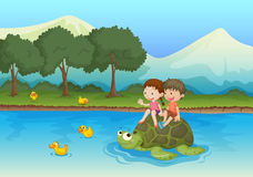 Kids on tortoise Royalty Free Stock Images