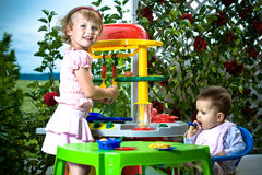 Kids and toy kitchen Stock Photography