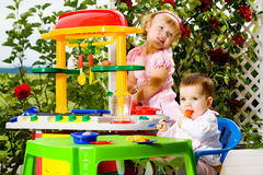 Kids and toy kitchen Royalty Free Stock Photo