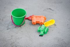 Kids toy on the sandy beach. On summer holidays royalty free stock photography