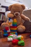 Kids toys background with teddy bear and colorful bricks royalty free stock photos