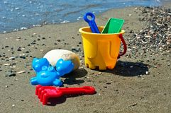 Kids toys on the beach. Kids bucket and toys on the beach Royalty Free Stock Photos