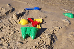 Kids toys on the beach. Colorful beach toys for kids in sand Stock Images