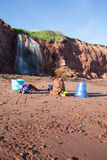 Kids Toys on Beach with Waterfall Stock Photography