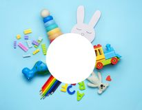 Kids toys on blue background with round copy space