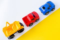Kids toys cars on white and yellow background. Top view. Flat lay. for text. Kids toys cars on white and yellow background. Top view. Flat lay. Copy space for stock images