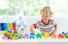 Kids toys. Child building tower of toy blocks stock images