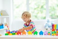 Kids toys. Child building tower of toy blocks stock photography