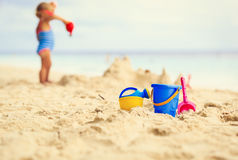 Kids toys and little girl building sandcastle. Family vacation Royalty Free Stock Image