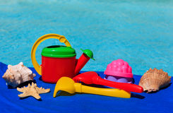 Kids toys at the swimming pool Stock Photos