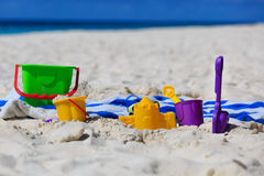 Kids toys on tropical beach Stock Images