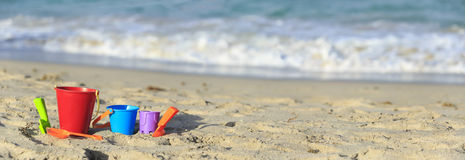 Kids toys on tropical sand beach Royalty Free Stock Images