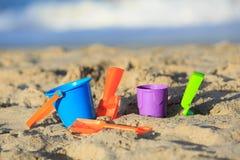 Kids toys on tropical sand beach Stock Image