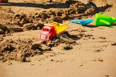 Kids toys on tropical sand beach. Set of plastic bright toys for children on the beach.colorful sand castle toys on Royalty Free Stock Photo