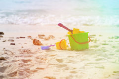 Kids toys on tropical sand beach Royalty Free Stock Photo