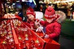Kids at Christmas fair. Children shopping xmas gifts. Stock Image