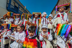 Kids in traditional costumes in the Plaza de Armas at Cuzco Peru Stock Photos