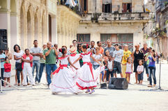 Kids in traditional Cuban clothes perform on street Stock Images