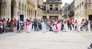 Kids in traditional Cuban clothes perform on street Royalty Free Stock Photo