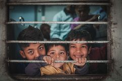 Kids on a train. Ajmer, India : 18th February, 2015 - Shot of three indian children looking happy with much anticipation and excitement travelling in a train Royalty Free Stock Photography