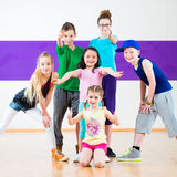 Kids train Zumba fitness in dancing school Royalty Free Stock Image